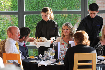 students serving in the restaurant